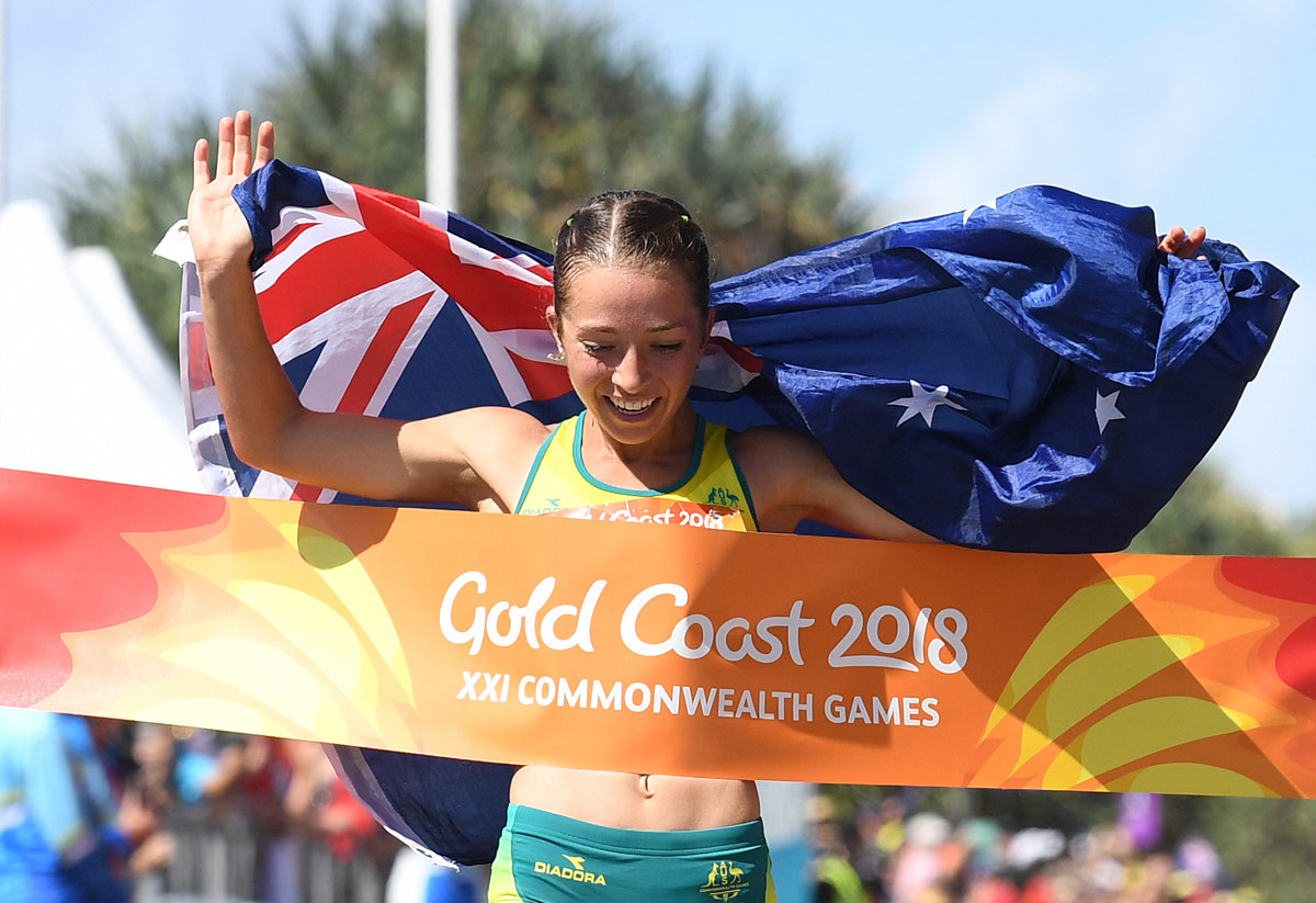 Elite athlete Jemima Montag crosses the finish line at the Commonwealth Games